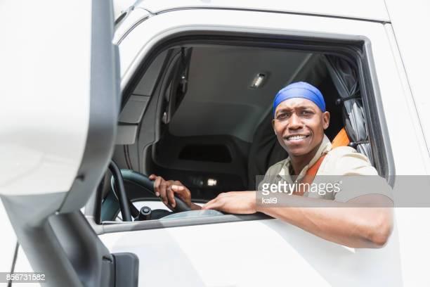 African-American man driving a truck