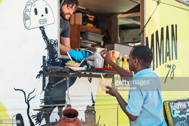 African-american man paying his order in a food truck.