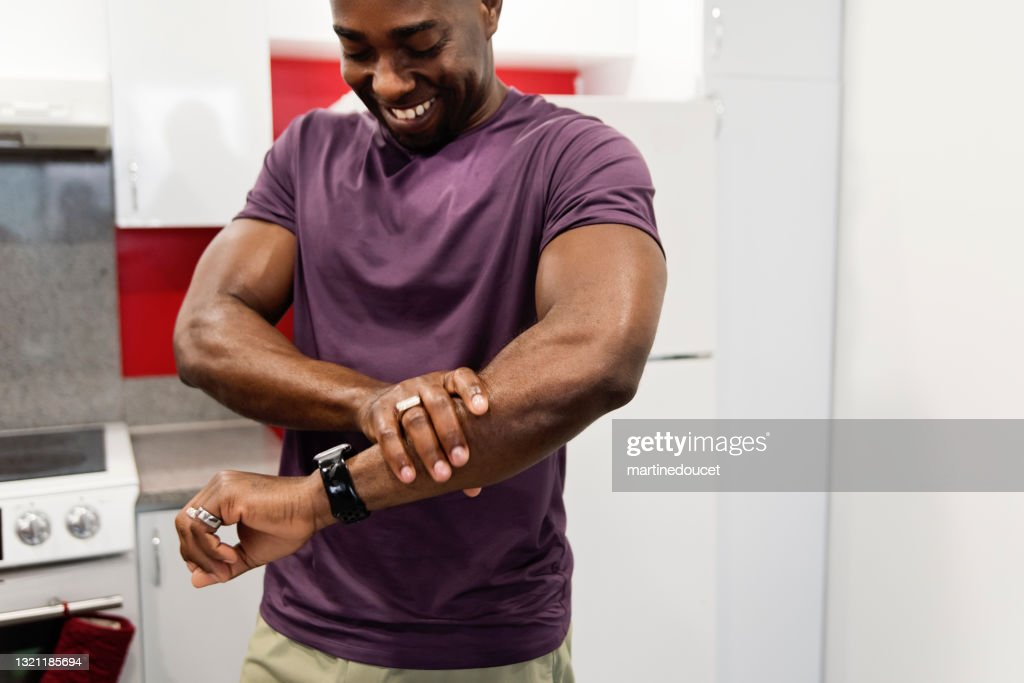 African-American man rubbing on homemade hand cream. : Stock Photo