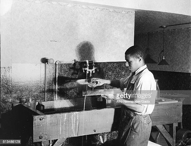 AfricanAmerican man washing a printing plate Baltimore Maryland 1960