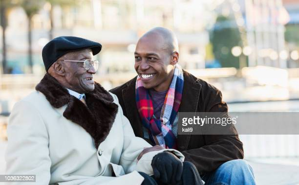 African-American man with grandfather In city