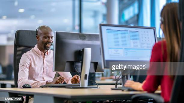 african-american man working as a call centre employee - it support stock pictures, royalty-free photos & images