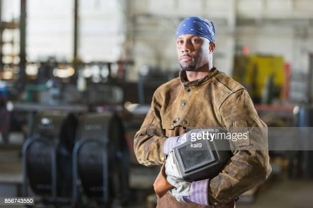 African-American man working as welder