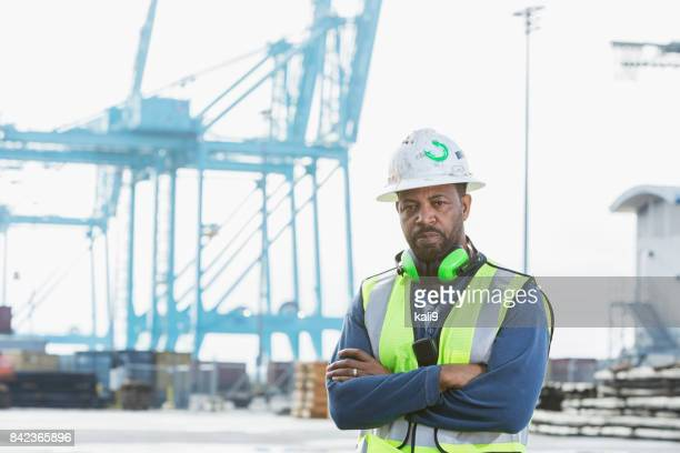 african-american man working at a shipping port - dock worker stock photos and pictures