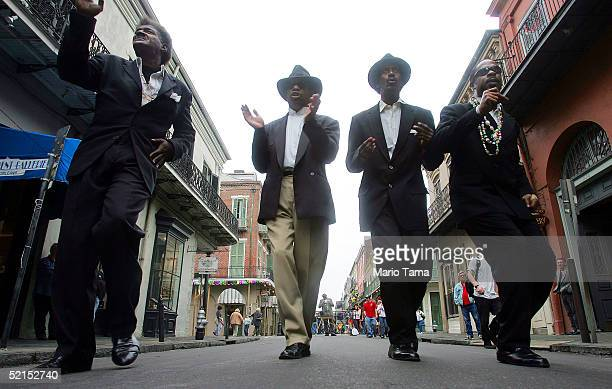 AfricanAmerican men sing on the street during Mardi Gras festivites February 7 2005 in New Orleans Louisiana Festivities will continue all weekend...