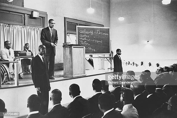 African-American Muslim minister and civil rights activist Malcolm X , giving a sermon at Temple 7 in Harlem, New York City, August 1963.