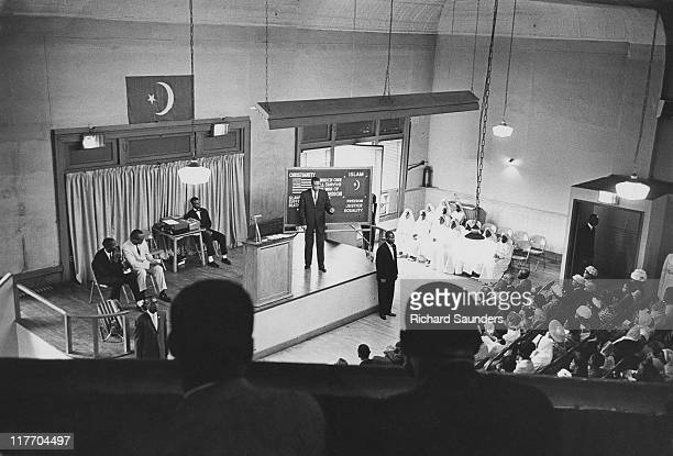 African-American Muslim minister and civil rights activist Malcolm X , preaching at Temple 7 in Harlem, New York City, August 1963.