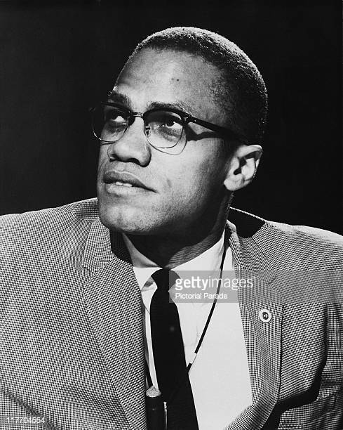 African-American Muslim minister and civil rights activist Malcolm X appearing on a round table discussion edition of the PBS programme 'Open Mind',...