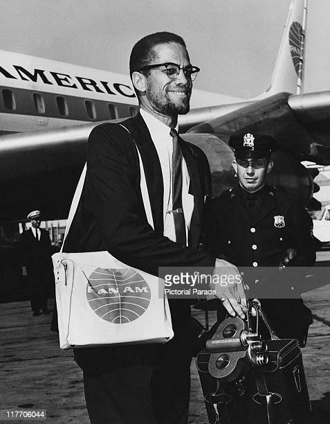 AfricanAmerican Muslim minister and civil rights activist Malcolm X arriving at John F Kennedy International Airport New York City after a tour of...