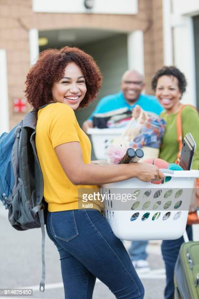 African-American parents helping daughter move