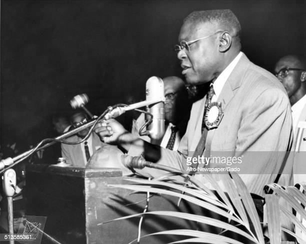 African-American pastor and former President of the National Baptist Convention Joseph Jackson speaking at a podium during an election and a National...
