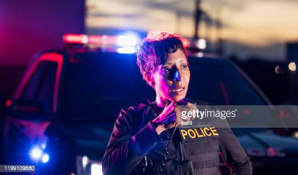 african-american policewoman talking on radio - police force stock pictures, royalty-free photos & images