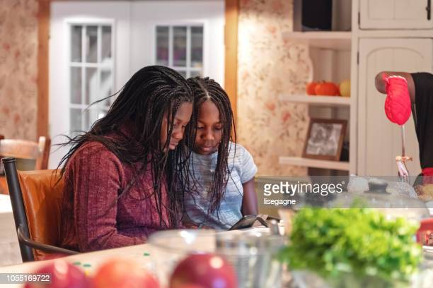 african-american preparing thanksgiving dinner - happy thanksgiving text stock pictures, royalty-free photos & images