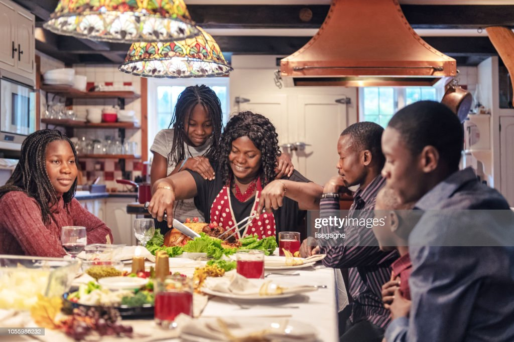African-American preparing thanksgiving dinner : Stock Photo