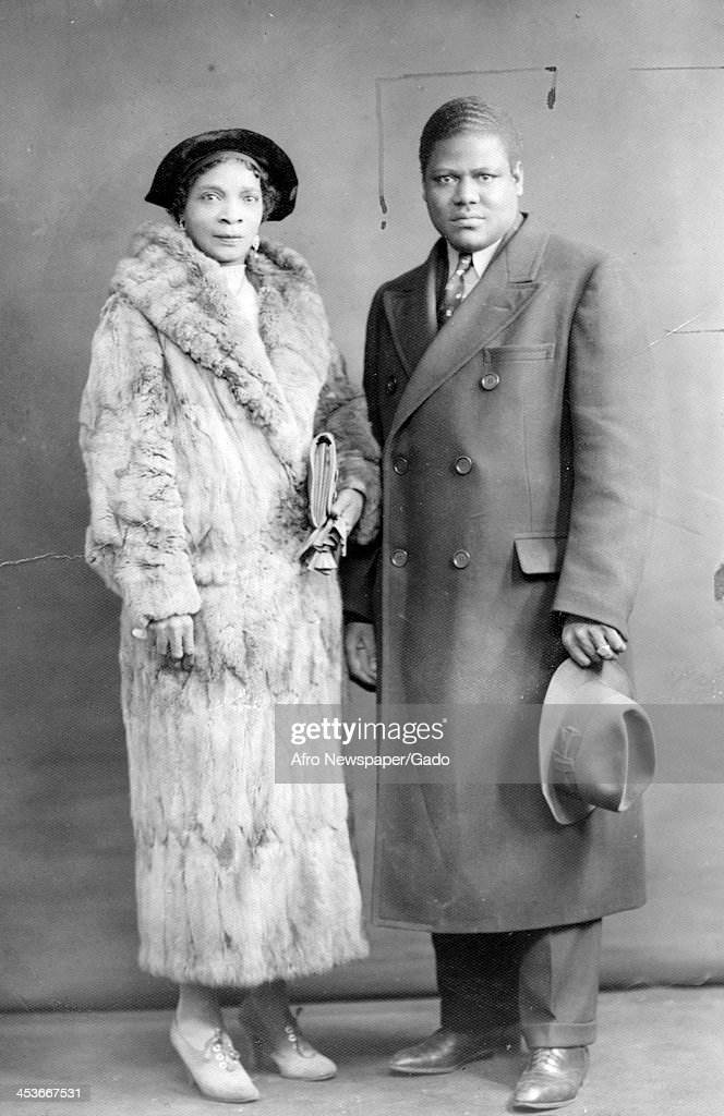 African-American religious and labor leader, Sufi Abdul Hamid (1903 - 1938) with his wife, Harlem mob boss, Stephanie Saint-Clair (1886 - 1969), in formal dress, January 23, 1938.