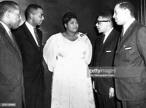 AfricanAmerican singer and Queen of Gospel Mahalia Jackson Frank Ellis Clarence Burley Archie Williams and James O Norris Baltimore Maryland 1959