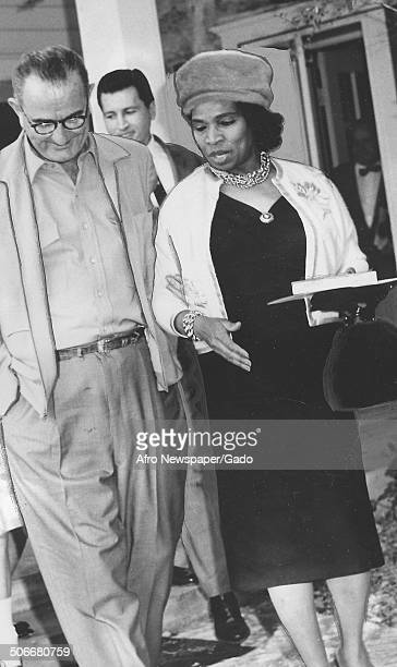 AfricanAmerican singer Marian Anderson and former United States President Lyndon B Johnson walking at LBJ ranch Austin Texas 1961