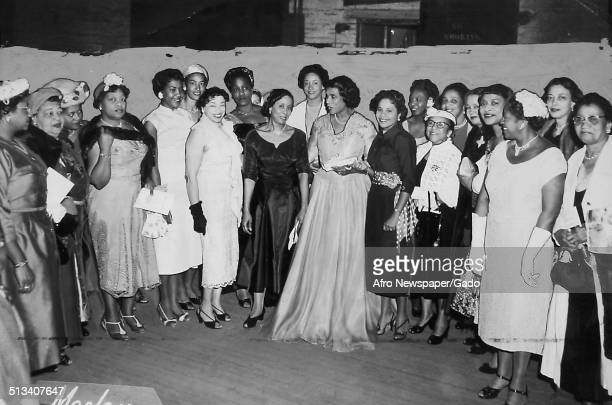 AfricanAmerican singer Marian Anderson and members of the Alpha Kappa Alpha sorority receiving an award at the Philadelphia Academy of Music...