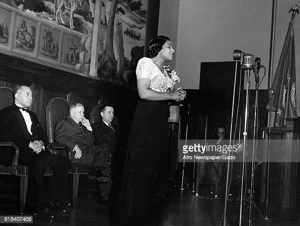 African-American singer Marian Anderson, lawyer and civil rights activist Charles Houston Hamilton and Harold Ickes posing on stage, 1939.