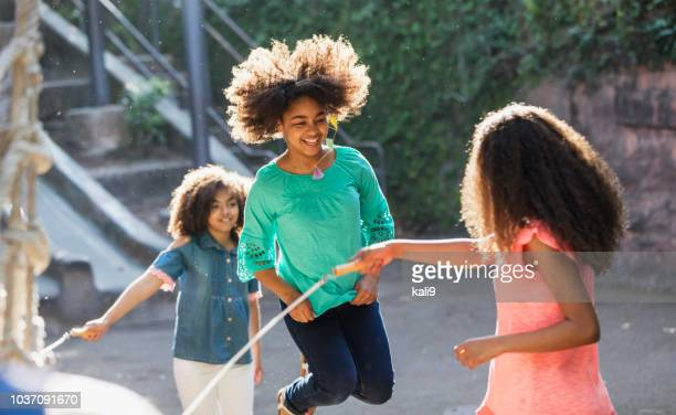 african-american sisters jumping rope - skipping rope stock pictures, royalty-free photos & images