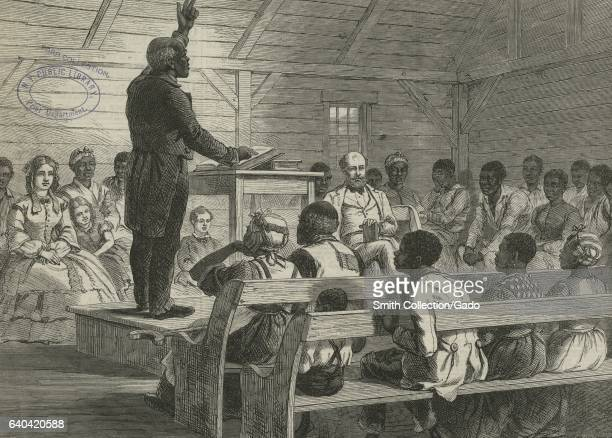 AfricanAmerican slave families worship in a plantation in South Carolina with one man leading the group 1863 From the New York Public Library
