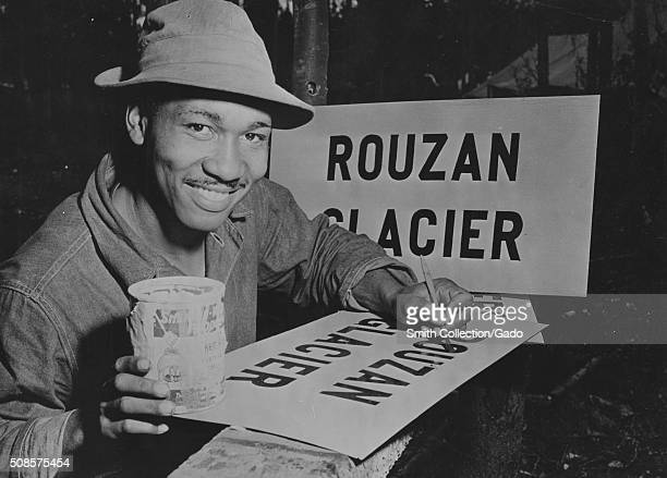 AfricanAmerican soldier painting a sign that reads Rouzan Glacier as part of the ALCAN highway project 1942 From the New York Public Library