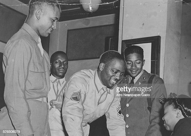 African-American soldiers and woman during a USO event during World War 2, September 19, 1942.