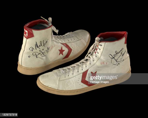 African-American sportsman Julius Winfield Erving II is regarded as one of the most influential basketball players of all time. Pair of white and red...