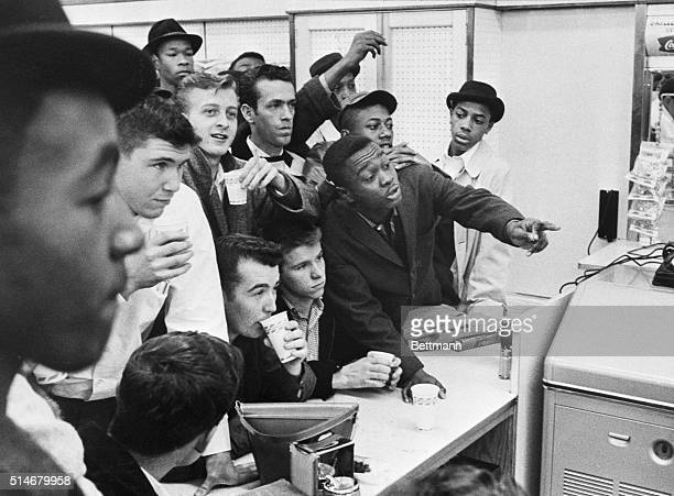African-American students attempt to get served at a lunch counter reserved for white customers in Portsmouth, Virginia, 16th February 1960.