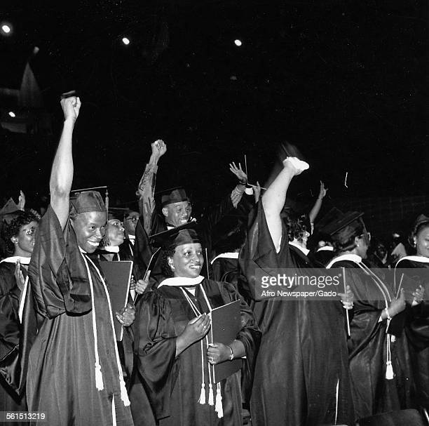 AfricanAmerican students giving a Black Power salute at Sojourner Douglas College during a graduation ceremony 1995