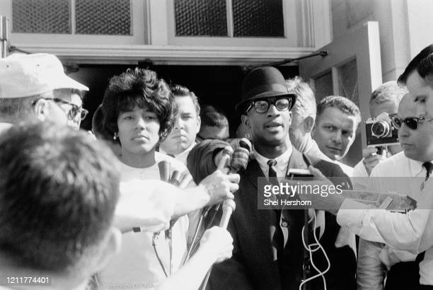 African-American students Vivian Malone and James Hood are interviewed by reporters, as segregation in schools was broken by their entrance to the...