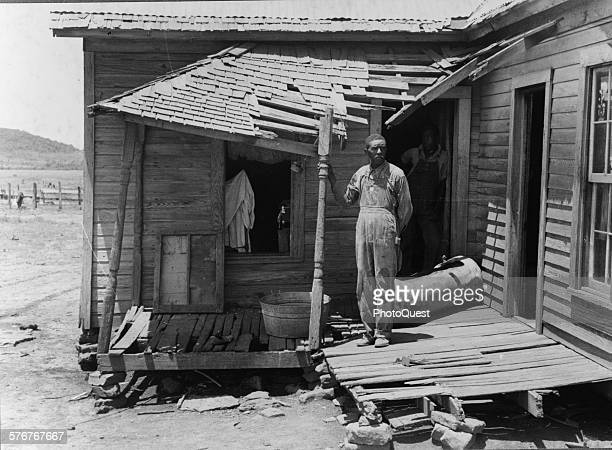 AfricanAmerican tenant farmer on his front porch South of Muskogee Oklahoma June 1939 The farm is owned by an outofstate woman and has been rented by...