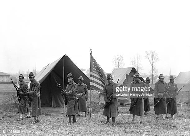 AfricanAmerican Troops Portrait Near Tents and American Flag circa 1917