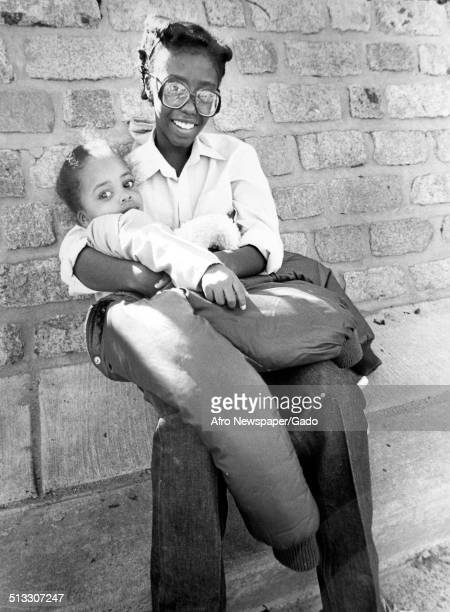 AfricanAmerican woman and baby during Baltimore City Fair Baltimore Maryland September 1980