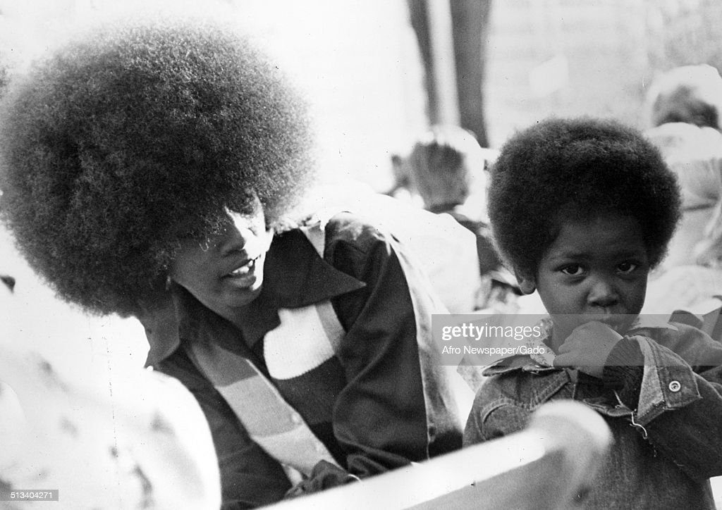 African-American woman and son wearing Afro haircut, during Baltimore City Fair, 1976.