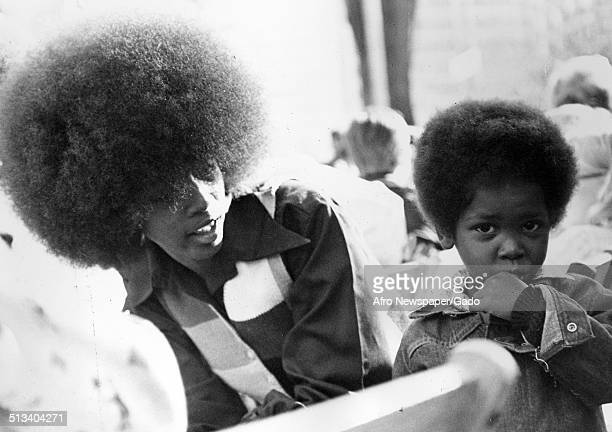 AfricanAmerican woman and son wearing Afro haircut during Baltimore City Fair 1976