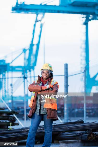 african-american woman, dock worker at shipping port - longshoremen stock pictures, royalty-free photos & images