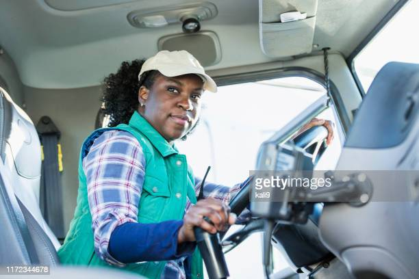 african-american woman driving a semi-truck - truck driver stock pictures, royalty-free photos & images