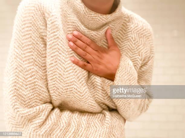 african-american woman experiences shortness of breath - chest torso stock pictures, royalty-free photos & images