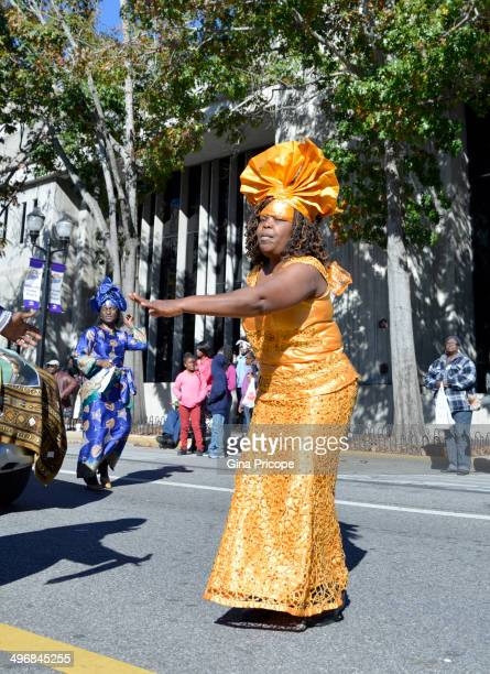 African-American woman in traditional costume during the parade of Martin Luther King in Orlando, Florida, January 18, 2014