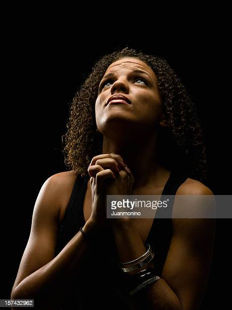 black woman praying stock photos and pictures getty images