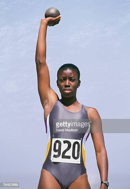 african-american woman preparing to throw shot put. california, usa. - shot put stock pictures, royalty-free photos & images