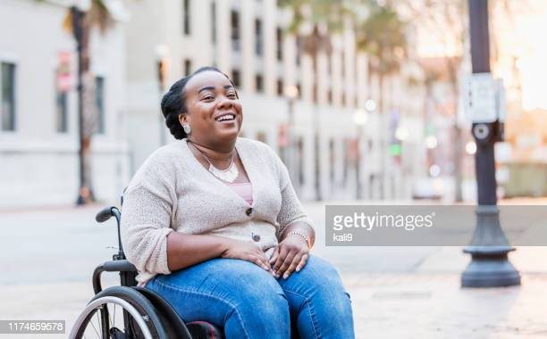 african-american woman with spina bifida - persons with disabilities stock pictures, royalty-free photos & images
