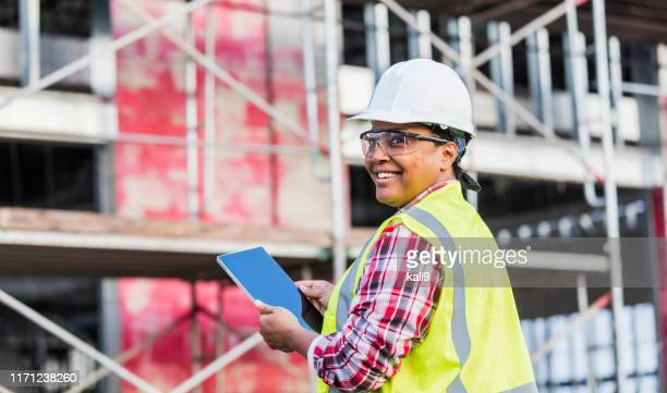 african-american woman working at construction site - construction industry stock pictures, royalty-free photos & images