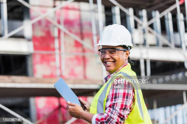 african-american woman working at construction site - eye protection stock pictures, royalty-free photos & images