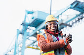 African-American woman working at shipping port