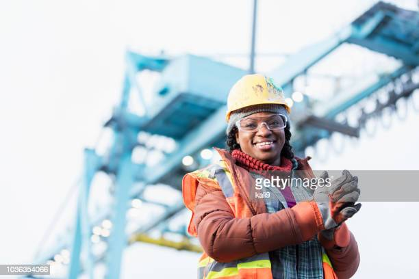 african-american woman working at shipping port - commercial dock stock pictures, royalty-free photos & images