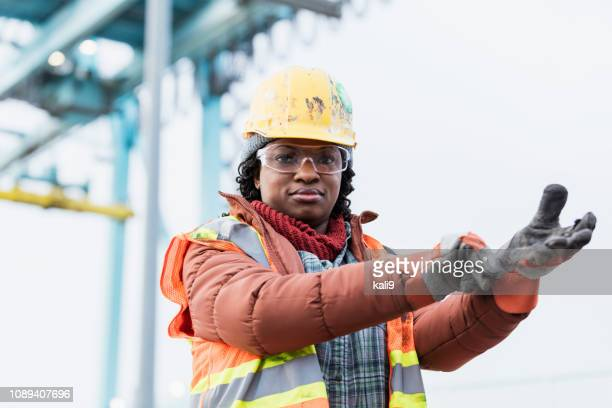 african-american woman working at shipping port - work glove stock pictures, royalty-free photos & images