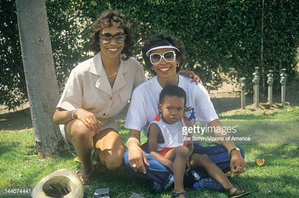 AfricanAmerican women and child sitting under a tree Los Angeles CA