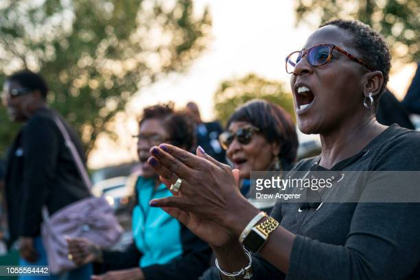 AfricanAmerican women cheer for Democratic candidate for US Senate Phil Bredesen greets voters during an early vote rally and fish fry outside the...
